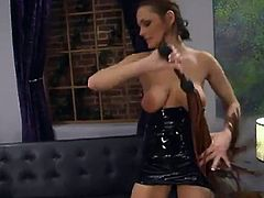 A brunette girl is dominating a guy in this video, torturing his cock and spanking and strapon fucking his ass in this femdom BDSM vid.