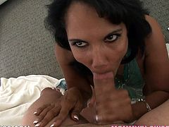 Kinky dark-haired mom Anjanette Astoria shows her big ass and hot pussy to some guy and kneels in front of him. She sucks and rubs his wang ardently and seems to enjoy it much.
