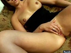 Divine brunette hottie sits on the couch with legs spread wide before she starts finger fucking her pierced pink vagina. Later she kneels down to give a head to strain cock in steamy sex video by Pornstar.
