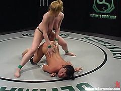 A couple of provocative cuties get naked and wrestle over who fucks the other with a strapon, hit play and check it out!