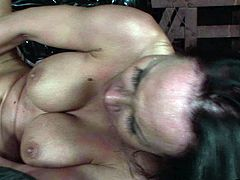 Hot blooded brunette lesbian lies with legs wide open while a horn made domina drills her punani with a sheer dildo in BDSM-styled lesbian sex vdieo by 21 Sextury.