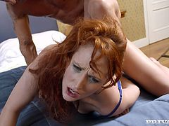 Stunning redhead MILF sucks big fat cock and then takes her clothes off. Later on she gets rammed in the ass from behind.