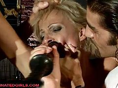 Horny blonde sluts Dara and Syndy Love are ready for hardcore bdsm domination. Watch them spreading legs to take toys and big cocks in the dungeon!