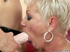 Extremely perverted mature woman loves fresh faced gals. She licks this girl's snatch greedily like a dirty whore. Then she bends over to let her fuck her mature snatch with strapon.