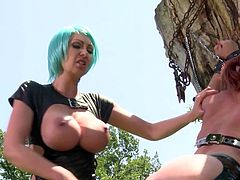 Brooke Haven and Leigh Darby are outdoors almost naked. The redhead gets whipped and bondaged as a punishment.
