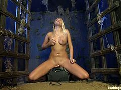 Lovely blonde chick strips her clothes off and have some fun in a crypt late at night. She toys herself with a vibrator and gets drilled by the fucking machine.