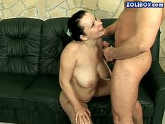 Country girl with big saggy boobs and fat ass is working her mouth on a hard stick sucking deepthroat. Then she gets her coochie licked too. After, the guy is pissing on her tits while she is sitting down on her knees.