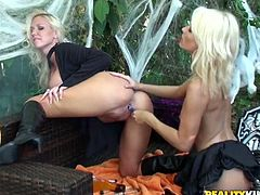 Stunning blonde girls in costumes have hot lesbian sex. They finger and lick each others pussies lying on a sofa. Later on they toy themselves with big dildos.