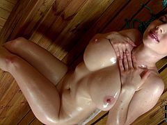 Karina Heart from the Czech Republic is so alluring, and it's always such a pleasure to see her showing her big natural tits and pouring oil all over them in the sauna.