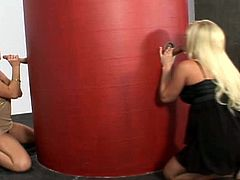 Busty blonde pornstars suck cock from a gloryhole