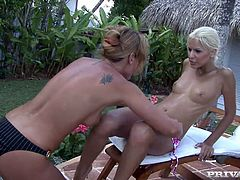 Boroka Balls and Kathy Campbel are having some fun in the yard. They lie on a beach chair and entertaing themselves by licking and fingering each other's sweet cunts.