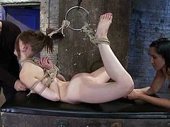 To the extreme tying and rope action Sensi Pearl suffers in this video we add that Isis Love is toying her pussy, we can say she's in a true BDSM vid.