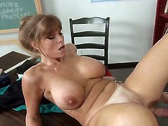 Lusty cock addicted brunette milf Darla Crane with huge firm knockers gives head to young dude David Loso with meaty fat cock and teaches him how to fuck in the office.