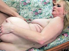 At first he polishes her pussy and licks her ass hole preparing it for hardcore anal fuck. Mature blonde moans hard while he pokes her anus from behind in missionary style.