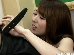 To motivate one of her students this cute Japanese teacher lets him plays with her boobs. She undoes her top and he squeezes her tits. She then gets down on her knees to sucks his cock. On the way down she licks his nipples and his chest, she's so fucking hot!