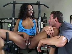 Luscious dark skinned babe Stacey Cash is hell seductive woman. She is up for sex any time. So she spreads her legs in a gym inviting thirsty guy to taste her juice.