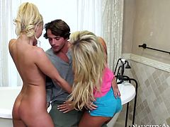 Two playful blond chics meet with a sexy neighbor outdoor. They head home after activities in fresh air to take a bath where he joins them in peppering threesome sex video by Naughty America.