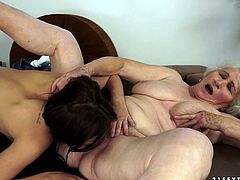 Fat and disgusting oldie is the owner of huge saggy tits and enormous wrinkled butt. This old lesbian desires to eat the wet fresh pussy of slim sexy brunette right on the sofa.