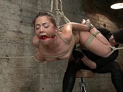 Stunning brown-haired girl gets tied up by her mistress. Later on she gets her ass toyed with a dildo and pussy with a vibrator at the same time.