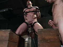 Christian Wilde and Troy Daniels are having some good time in a jail. Troy binds and torments Christian and then fucks his tight butt from behind.