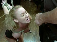 Kinky blonde chick shows her nude body to a crowd. Later on she sucks dicks and gets fucked hard by some guys.