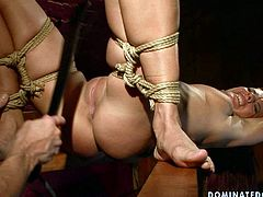 Whorish red-haired chic gets her tits tied with rope in BDSM sex scene