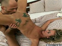 Skinny tattooed blonde Suze is having a good time with some dude indoors. The guy eats Suze's shaved pussy and then makes the hottie suck his dick and fucks her doggy style.