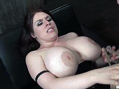 The chubby brunette with huge boobs Daphne Rosen is torturing and playing with a guy in this femdom bondage video.