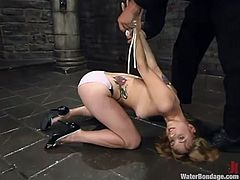 Kinky blonde milf Pinky Lee allows some guy to tie her up in an underground and rub her vag with a dildo. Then the man pours cold water on the bitch and makes her moan loudly.