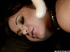 Lascivious brunette babe stands in doggy pose with her legs and hands handcuffed while a perverse domina forces her suck a dildo and later fuck her vagina with it in BDSM-styled sex video by 21 Sextury.
