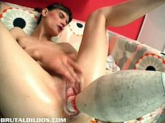 This skinny amateur puts a real bowling pin inside her cunt. She uses a lot of lube to make it fit in.