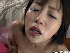 Hot Japanese chick sucks three dicks without stopping. She gets her her mouth filled with big load of cum.