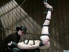 Lewd brunette Juliette March lets some guy tie and hang her up in a basement. Then the man attaches clothespegs to Juliette's body and makes the bitch take a ride on a fucking machine.