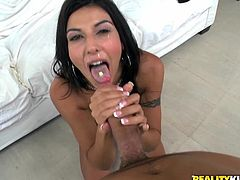 A slutty-ass fucking bitch with a tramp stamp and pierced pussy sucks on a hard cock and gets it shoved balls deep into her cunt.