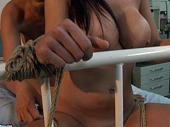 Tied up busty brunette VIVIEN moans while getting her clit rubbed