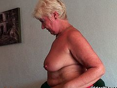 Full figured grandma Sandie strips off her clothes and gives her old pussy a workout. Watch as mature amateur gets naked, opens her legs and shows off.