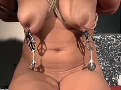 Horny brunette teaches pale blondie with small tits what bondage is about. Black haired chick ties her up with ropes and then gets ready to put this submissive blond nympho in some BDSM stuff.
