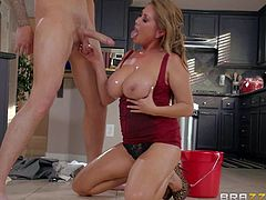 Kianna Dior is a curvy Chinese MILF with with absolutely amazing massive tits. She seduces her sons buddy in the kitchen and takes his cock. He plays with her wet melons and she sucks his rod on the floor.