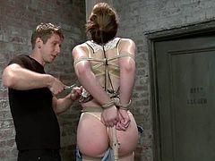 Pretty girl gets tied up and face fucked by her master. Later on he pours hot wax on her body and toy her ass with big dildo.