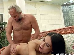 Fuckable brunette doxy gets her fresh shaved cunt pounded from behind in sideways position before she bends down for a drill from behind by aroused grey-haired daddy. Later she gets her face cumshot in peppering sex video by 21 Sextury.