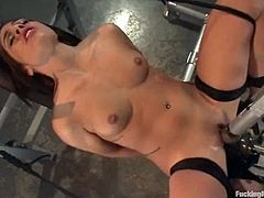 Superb brown-haired girl undresses and then gets her pussy toyed with a vibrator. In addition she gets her pussy drilled by the fucking machine.