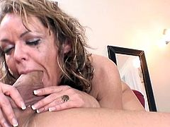 Spicy blonde Kelly Leigh is giving a deep blowjob