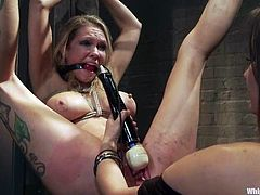 Maitresse Madeline and Rain DeGrey are getting naughty in a basement. Madeline ties Rain and whips her butt before she smashes her coochie with a toy.