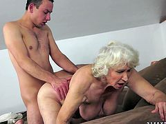 Old woman gets undressed by a guy and then she gets her old pussy licked. Later on she gets fucked in side-to-side position.