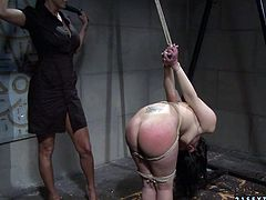 Curvy brunette babe is bandaged by insatiable domina before she forces her bend down and proceeds to slapping her round juicy ass till it turns red in BDSM-involved sex video by 21 Sextury.