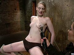 Cute redhead chick Ela Darling allows Isis Love to bind her in a basement. Isis rubs Ela's vag with a dildo, then attaches wires to her body and sits down on her face afterwards.