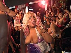 A group of horny drunk milfs are having fun with a few men in a club. The women show their boobs to the studs and then allow the guys to poke their dicks into their hot mouths.