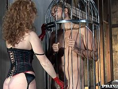 Curly-haired redhead milf Audrey Hollander is playing dirty games with some guy in a jail. She makes the dude lick her cunt and then takes a fervent ride on his dick.