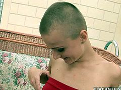 Short-haired nymphomaniac with small tits is here to show what she can do with her fist! She slips it inside her muff and starts her crazy fisting session.