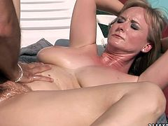 Ample red-haired MILF lies on her back on the deck chair outdoor while a kinky dude fists her soaking bearded cunt and later pokes her anus in doggy style.